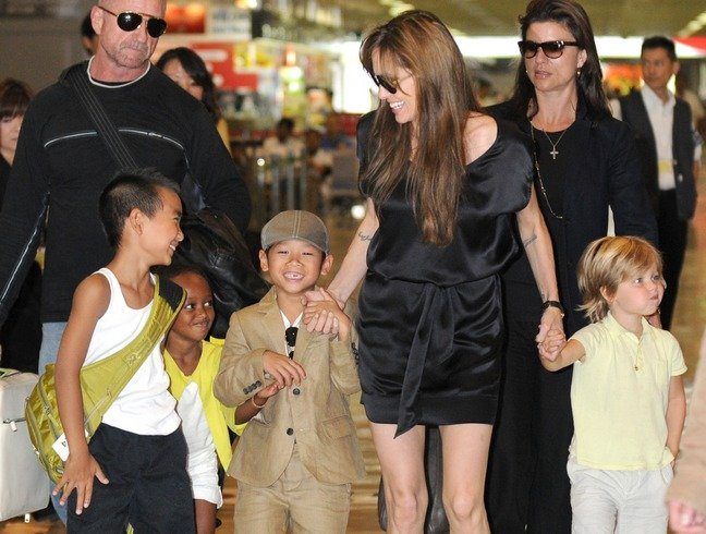Angelina Jolie black silk mini dress, flip flops, Pax, Maddox, Shiloh, Zahara