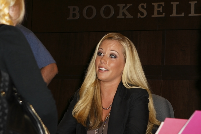 Kendra Wilkinson, black jacket, brown shirt, layered necklace
