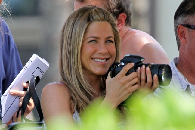 Jennifer Aniston, white blouse, camera