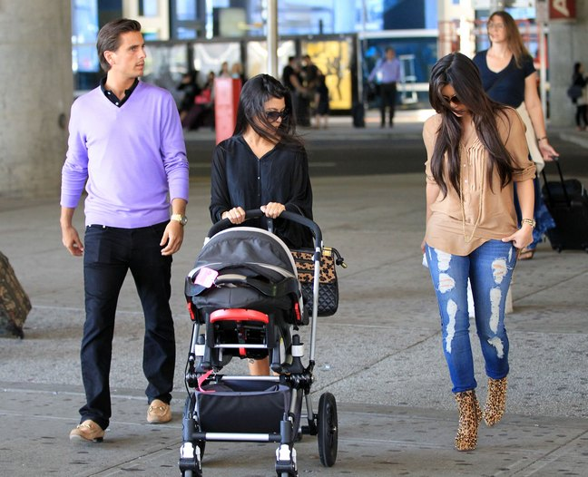 Kourtney Kardashian, black top, diaper bag, stroller, kim kardashian, ripped jeans, animal print boots, beige top, brown shirt, scott disick, lavendar sweater,