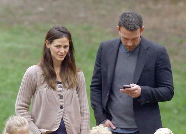 Ben Affleck, gray shirt, suit jacket, Jennifer Garner, brown sweater, beige sweater, jeans, athletic shoes