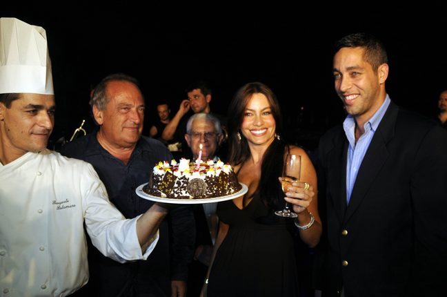 Sofia Vergara, black dress, bracelet, champagne glass, earrings, watch, birthday cake