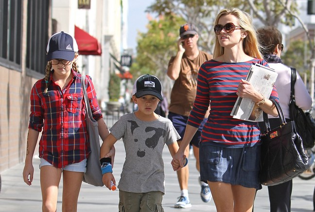 Reese Witherspoon, red and blue striped shirt, red and blue long sleeved shirt, blue mini skirt, sunglasses