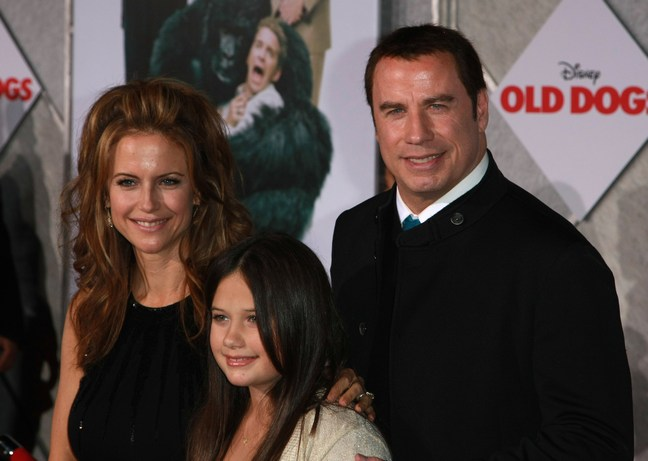 John Travolta, black sweater, Kelly Preston, black dress, Ella Bleu