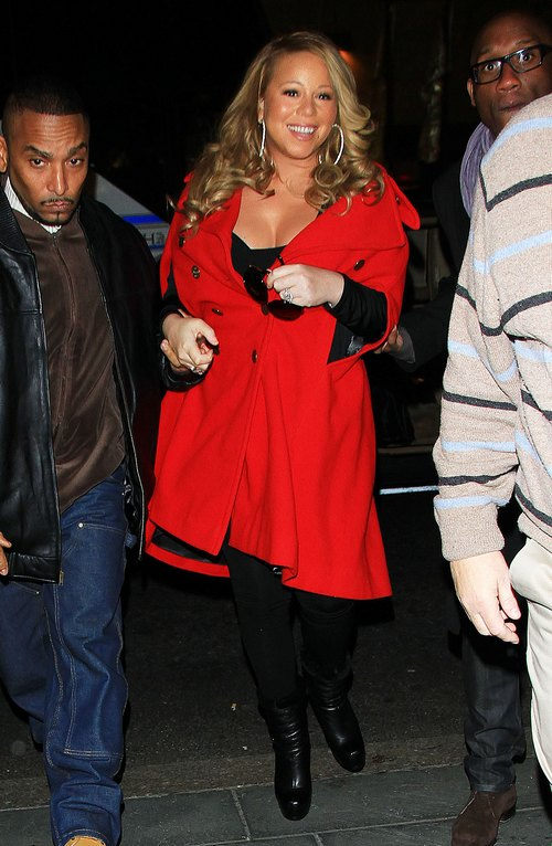 Mariah Carey, red winter jacket, black pants