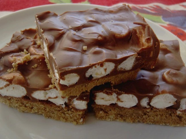 Smores dessert bars cut up and presented on a plate