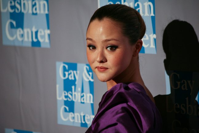 Devon Aoki, purple silk dress