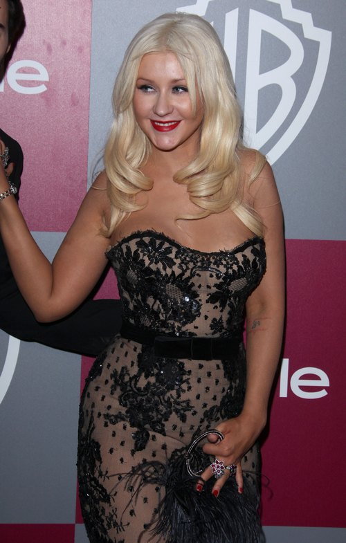 Christina Aguilera black and nude dress