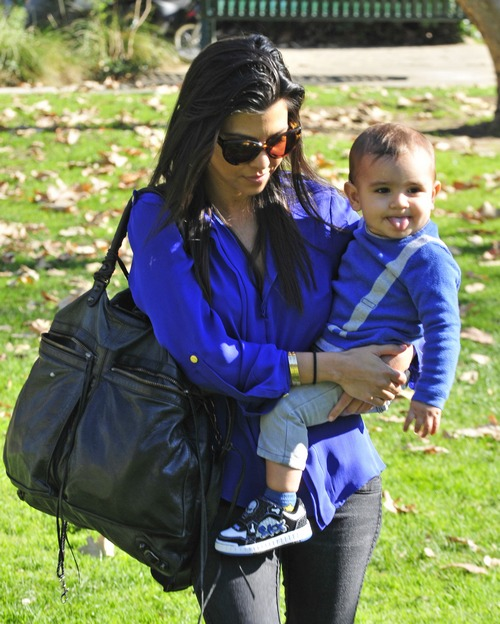 Kourtney Kardashian, blue shirt, sunglasses,