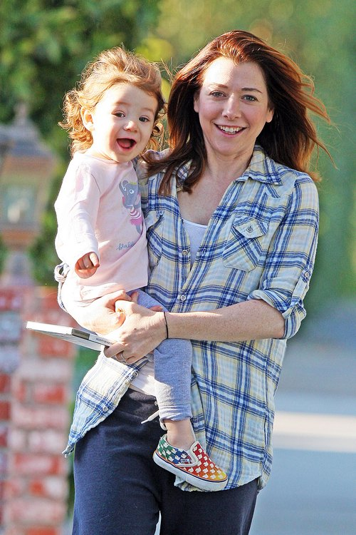 Alyson Hannigan, plaid shirt, blue pants