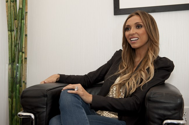 Giuliana Rancic, black jacket, sequined top, jeans