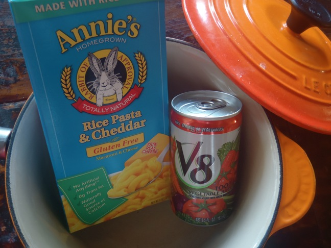 Annie's Homegrown Mac and Cheese pictured with a can of V8 in a empty pot