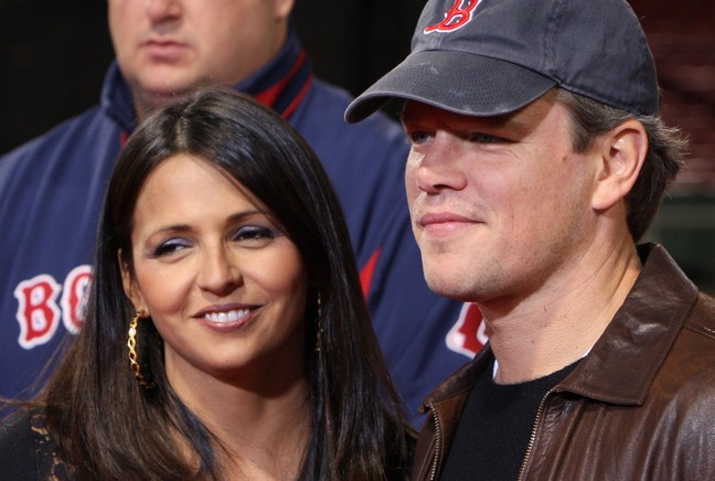 Matt Damon blue baseball hat, brown leather jacket