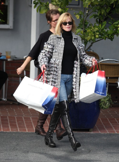 Melanie Griffith black and white coat, jeans, zipper boots