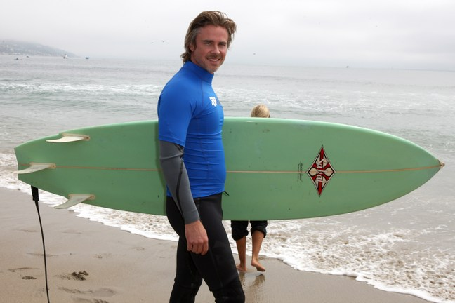 Sam Trammell, surf board, wet suit