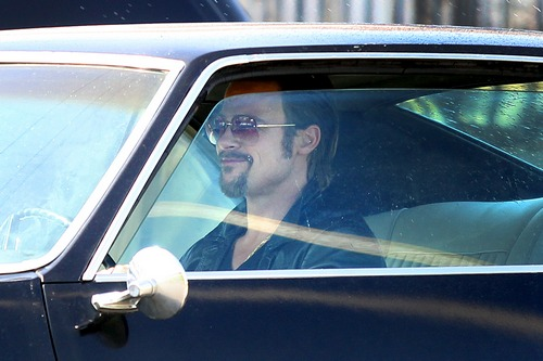 Brad PItt, black leather jacket, cogan, black car, movie set