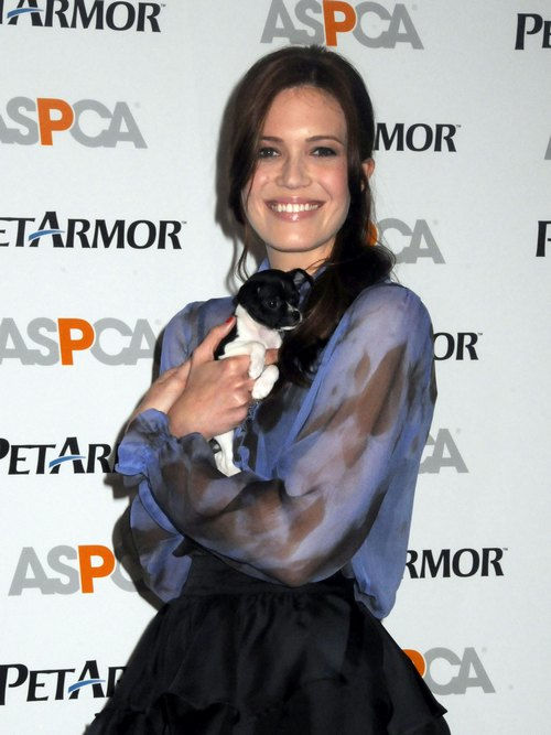 Mandy Moore black skirt, sheer floral shirt