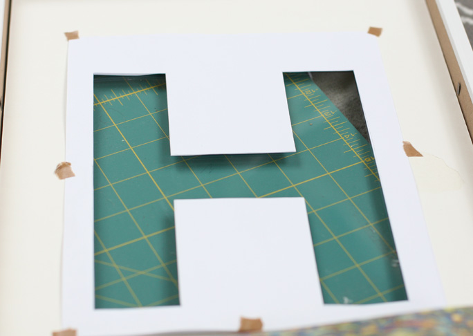 Diy framed letter wall art now place the mat board into the frame and carefully tape the white letter into place spiritdancerdesigns Images