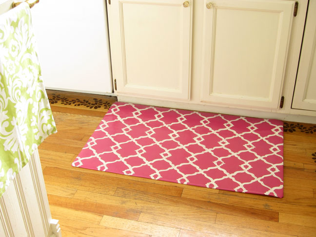 pink quatrefoil rug on a wooden floor