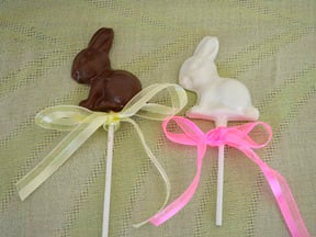 Chocolate Easter Bunnies - Step 8 homemade chocolate bunnies on lollipop sticks with colorful ribbon