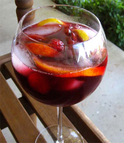 A glass of homemade raspberry sangria