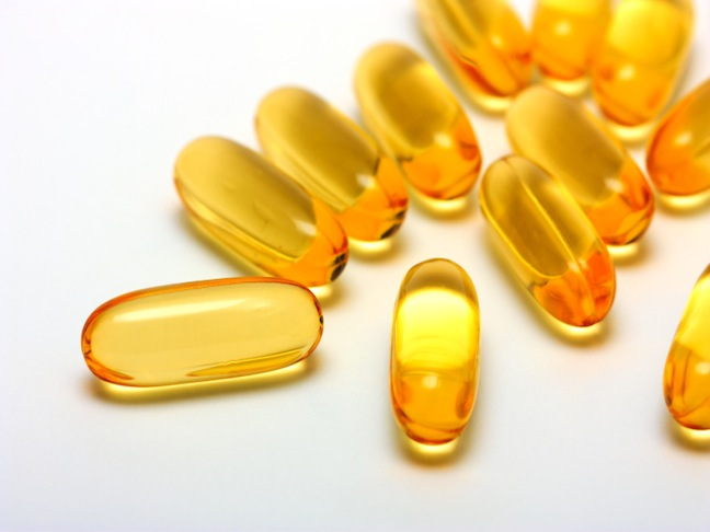 gold colored gel capsules of vitamin q