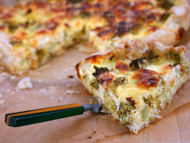 a slice of broccoli and chicken quiche