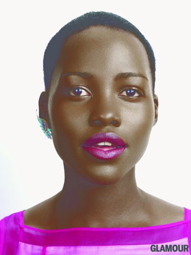 Lupita Nyongo with fuschia lips staring off in to the distance