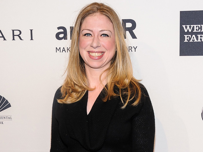 Chelsea Clinton smiling in a black dress