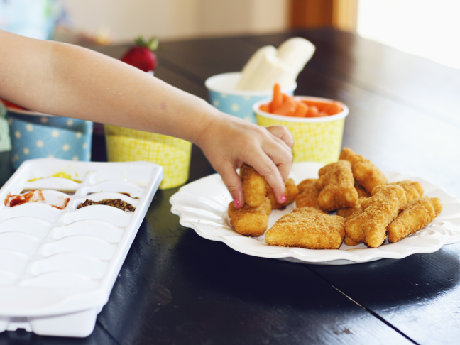 hand reaching for nuggets