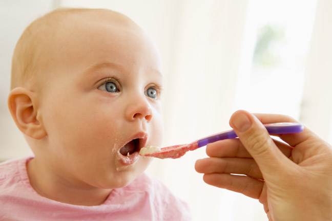 feeding-baby-first-solid-food-pink-spoon