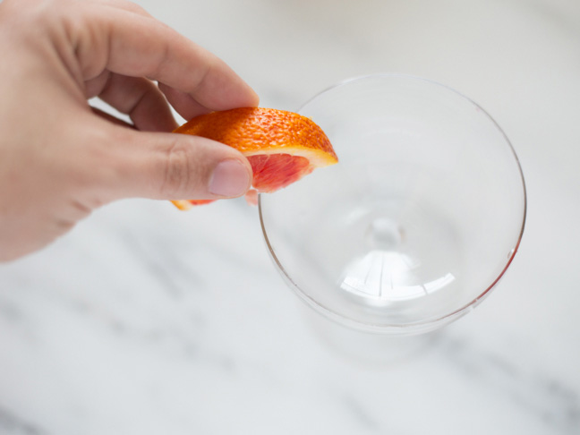 blood-orange-coupe-glass-rim-hand