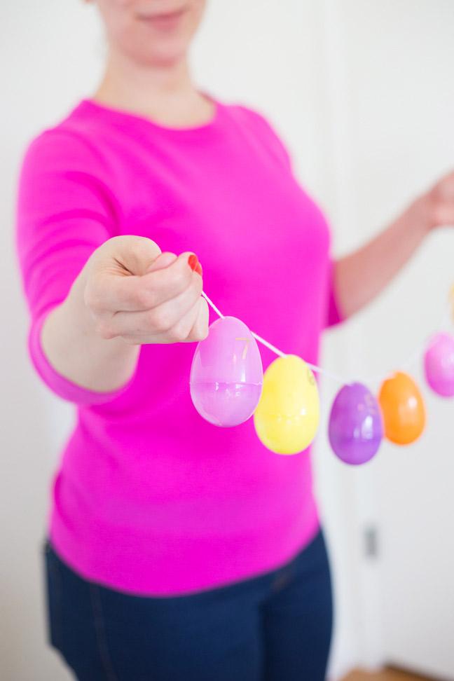 plastic-easter-egg-garland-hands-side-view