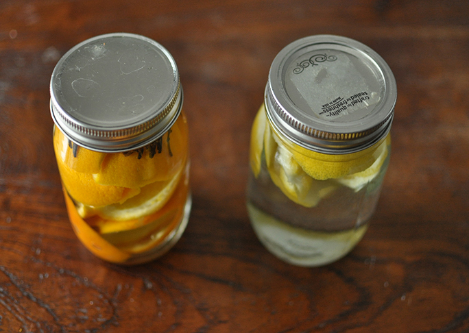 lemon and orange all natural household cleaner in mason jars