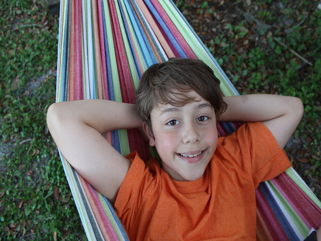 boy laying in hammock