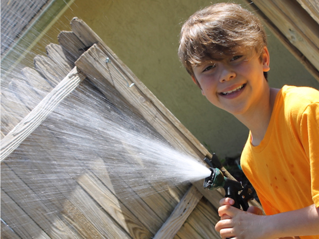 gardening-with-hose-kid-child-boy