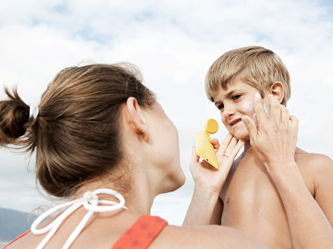 mom-applying-sunblock-to-son