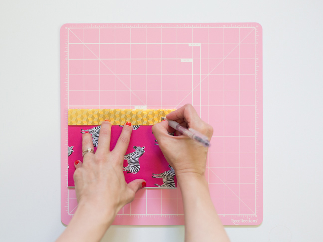 hands-pen-cutting-mat-measuring