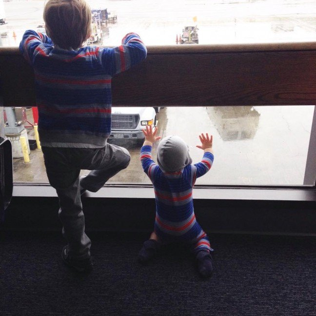 two kids watching planes airport