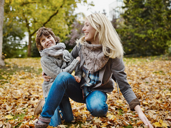 mother-son-leaves-fall-cozy