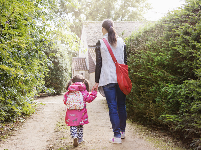 mum-daughter-walking-to-school-uk