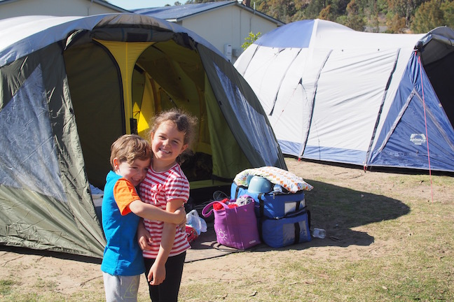 kids in front of the tent