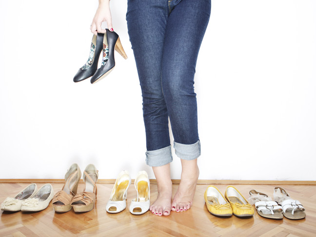 woman-jeans-trying-on-shoes
