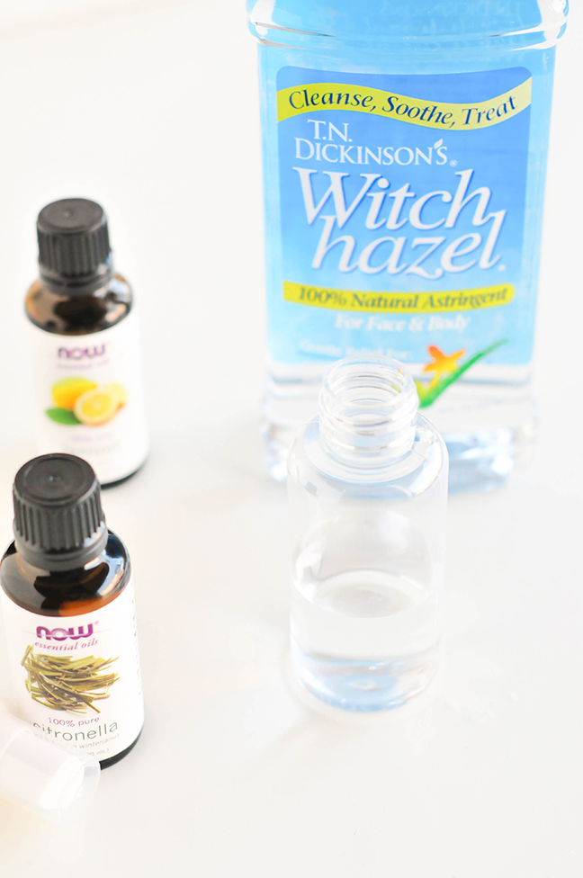 filling bottle with boiled or distilled water for bug spray recipe