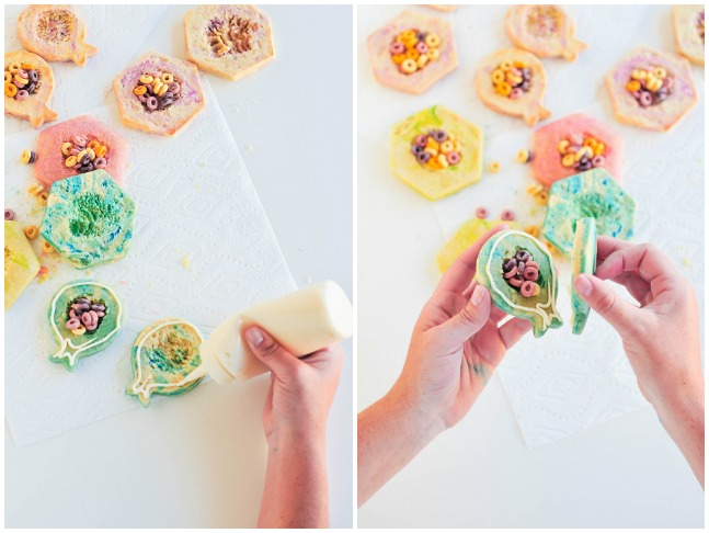 combining two sugar cookies with frosting