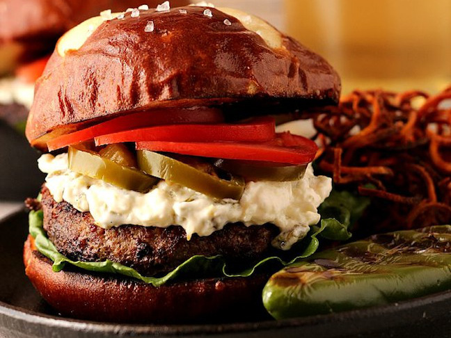 pretzel bun burger with potato salad