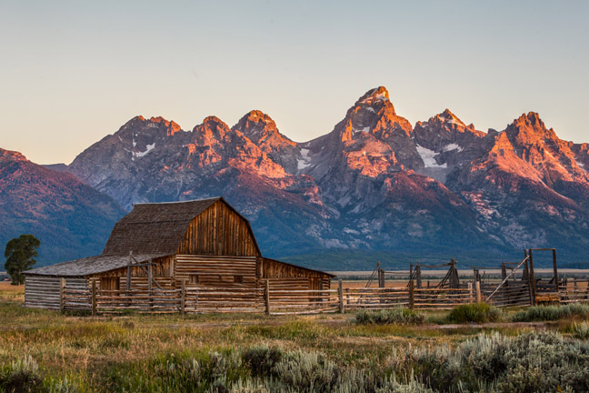 Sunrise at Mormon Row with T.A. Moulton barn and Teton range, Grand Teton National Park.