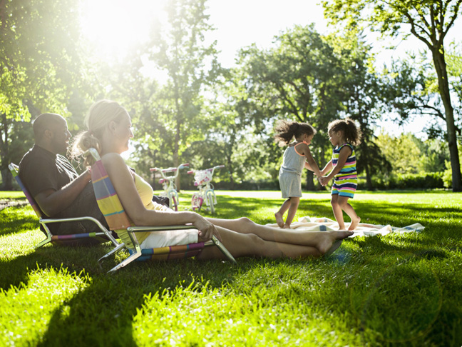 family-hanging-out-in-park-daughters-girls