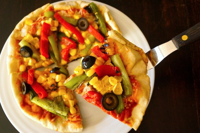 corn-peppers-black olives-yellow-pizza-white plate