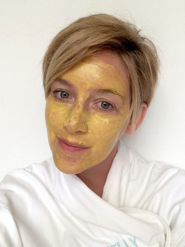 woman wearing yellow face mask